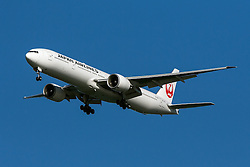 Japan Airlines Boeing 777-346ER (registration JA740J) approaches San Francisco International Airport (SFO) over San Mateo, California, United States of America