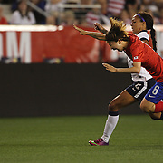 Sydney Leroux, USA, and Lim Seoyeon, North Korea, challenge for the ball during the U.S. Women Vs Korea Republic friendly soccer match at Red Bull Arena, Harrison, New Jersey. USA. 20th June 2013. Photo Tim Clayton