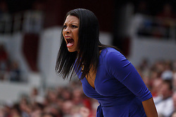 January 20, 2011; Stanford, CA, USA;  UCLA Bruins head coach Nikki Caldwell yells at her team from the bench during the first half against the Stanford Cardinal at Maples Pavilion.