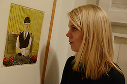 © Licensed to London News Pictures.04/02/2014. London, UK. A member of staff looks at David Hockney's lithograph 'Self Portrait' during a press view of the 'Hockney, Printmaker' exhibition in Dulwich Picture Gallery.The gallery celebrates 60 years of the British artist David Hockney's printmaking. Photo credit : Peter Kollanyi/LNP