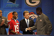 Tampa Bay Buccaneers wide receiver Keyshawn Johnson appears with a contestant and show host Pat Sajak on NFL Players Week on Wheel of Fortune on 11/04/2003. ©Paul Anthony Spinelli/NFL Photos