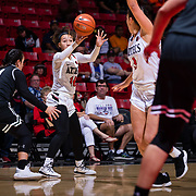 09 November 2018: San Diego State Aztecs guard Naje Murray (10) passes the ball to guard Mallory Adams (3) as she cuts to the basket in the first quarter. The Aztecs opened up it's regular season schedule with a 58-57 win over Hawaii Friday at Viejas Arena.
