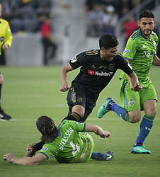 April 29, 2018 - Los Angeles, California, U.S - Carlos Vela #10 of the LAFC is fouled by Gustav Svensson #4 of the Seattle Sounders during their MLS game on Sunday April 29, 2018, their first game at the Banc of California Stadium in Los Angeles, California. LAFC defeats Sounders, 1-0. (Credit Image: © Prensa Internacional via ZUMA Wire)