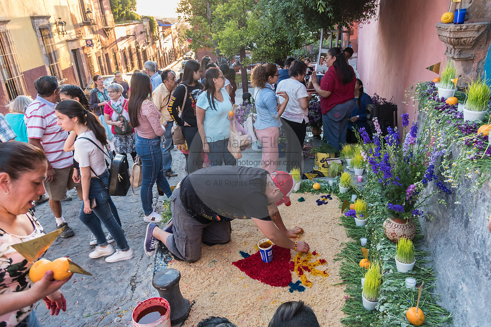 A Mexican man prepares a community altar celebrating El Viernes de Dolores during Holy Week March 23, 2018 in San Miguel de Allende, Mexico. The event honors the sorrow of the Virgin Mary for the death of her son and is an annual tradition in central Mexico.