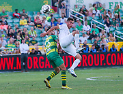 Swope Park Rangers defender Mo Abuainadi(60) and Tampa Bay Rowdies forward Sebastian Guenzatti(13) battle for the ball during a USL soccer game, Sunday, May 26, 2019, in St. Petersburg, Fla. The Rowdies defeated the Rangers 1-0. (Brian Villanueva/Image of Sport)