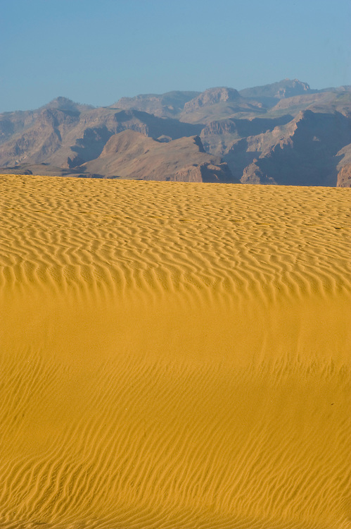 The sand dunes of Maspalomas beach at sunset, in Gran Canaria Island, Canary Islands, Spain.