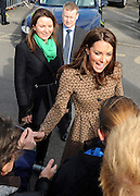 © Licensed to London News Pictures. 21/02/2012, Oxford, UK. Kate Middleton meets members of the public who have waited in the freezing cold for over two hours outside the school. The Duchess of Cambridge Kate Middleton leaves Rose Hill Primary School in Oxford today 21 February 2012. Photo credit : Stephen Simpson/LNP