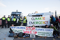 London, UK. 17th November, 2018. Environmental campaigners from Extinction Rebellion block Lambeth Bridge, one of five bridges blocked in central London, as part of a Rebellion Day event to highlight 'criminal inaction in the face of climate change catastrophe and ecological collapse' by the UK Government as part of a programme of civil disobedience during which scores of campaigners have been arrested.