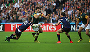 South Africa's Damian De Allende  getting tackled by USA Chris Wyles during the Rugby World Cup Pool B match between South Africa and USA at the Queen Elizabeth II Olympic Park, London, United Kingdom on 7 October 2015. Photo by Matthew Redman.