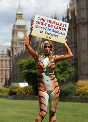 © licensed to London News Pictures. LONDON, UK  07/06/11. Chantel Houghton, former Big Brother contestant, poses in Westminster wearing only tiger-striped body paint to protest with PETA for a ban on wild animals in circuses. Please see special instructions for usage rates. Photo credit should read Matt Cetti-Roberts/LNP