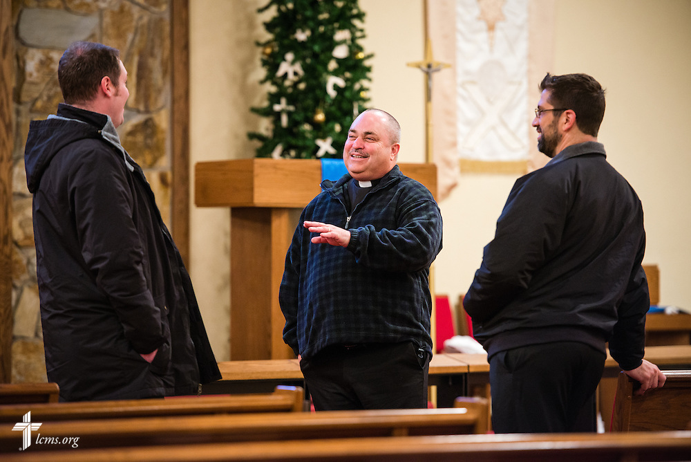 Rev. Thomas Heren (center) of Our Savior Lutheran Church in Washington, Ill., talks with Rev. Michael W. Meyer, manager of LCMS Disaster Response (left), and  Rev. Ross E. Johnson (right), director of LCMS Disaster Response, on Wednesday, Dec. 18, 2013.  Nearly two dozen tornadoes plowed through Illinois in November, killing a total of seven. The damaged LCMS church served as a relief center for members and nearby residents. LCMS Communications/Erik M. Lunsford