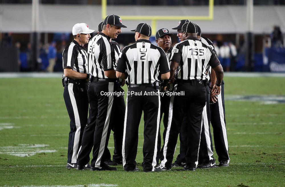 NFL officials huddle during the Los Angeles Rams 2016 NFL preseason football game against the Kansas City Chiefs on Saturday, Aug. 20, 2016 in Los Angeles. The Rams won the game 21-20. (©Paul Anthony Spinelli)
