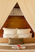"Bed in guest bure ""Lima"" at Matangi Private Island Resort, Fiji."