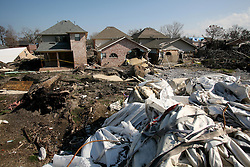30 Jan, 2006. New Orleans, Louisiana. Post Katrina.<br /> Site of the 17th street canal breach in Lakeview, looking away from the levee toward the houses directly behind the breach. Remains of giant bags of ballast dropped by helicopters at the time of the hurricane to try and slow the flow of water remain on site. Much of the city remains in ruins 5 months after hurricane Katrina destroyed the levees, flooding the area.<br /> Photo; Charlie Varley/varleypix.com