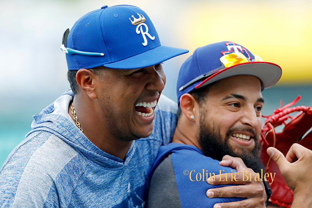 Kansas City Royals' Salvador Perez, left, reacts as he hugs Texas Rangers' Rougned Odor, right, as they visit during batting practice before a baseball game at Kauffman Stadium in Kansas City, Mo., Tuesday, May 14, 2019. The six-time All-Star catcher is not playing this season after undergoing Tommy John surgery in March to repair ligament damage to his right elbow . AP Photo Colin E. Braley