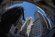 Distorted fish-eye lens view of George Washington statue and classical pillars of the New York Stock Exchange (NYSE) on Wall Street, Lower Manhattan,.