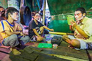 27 APRIL 2013 - BANGKOK, THAILAND:   A family of Chinese opera performers get ready to go on stage before a Chinese opera performance in the Talat Noi neighborhood of Bangkok's Chinatown. Chinese opera is a family endeavor and many times children grow up performing alongside their parents. Chinese opera was once very popular in Thailand and is usually performed in the Teochew language. Millions of Chinese emigrated to Thailand (then Siam) in the 18th and 19th centuries and brought their cultural practices with them. Recently its popularity has faded as people turn to performances of opera on DVD or movies. There are as many 30 Chinese opera troupes left in Bangkok. They travel from Chinese temple to Chinese temple performing on stages they put up in streets near the temple, sometimes sleeping on hammocks they sling under their stage. The opera troupes are paid by the temple, usually $700 to $1000 a night.  PHOTO BY JACK KURTZ