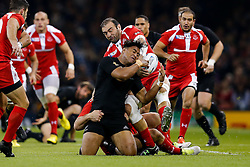 New Zealand Winger Julian Savea is tackled by Georgia Flanker Mamuka Gorgodze (capt) who wins the ball - Mandatory byline: Rogan Thomson/JMP - 07966 386802 - 02/10/2015 - RUGBY UNION - Millennium Stadium - Cardiff, Wales - New Zealand v Georgia - Rugby World Cup 2015 Pool C.