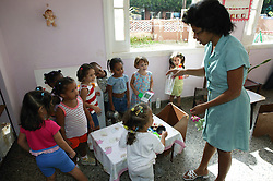 Teacher with group of children at Havana nursery school,