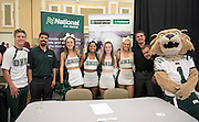 The Ohio University cheerleaders pose with representatives from National Car Rental and Enterprise during the 1st Annual Supplier Fair held at Ohio University's Baker Center Ballroom on September 7, 2016.