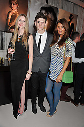 Left to right, FREYA McHUGH, REECE SANDERS and HELENA CHRISTENSEN at the unveiling of the Helena Christensen and Swarovski Crystallized Unsigned Model search winners held at Swarovski Crystallized, 24 Great Marlborough Street, London on 26th January 2012.
