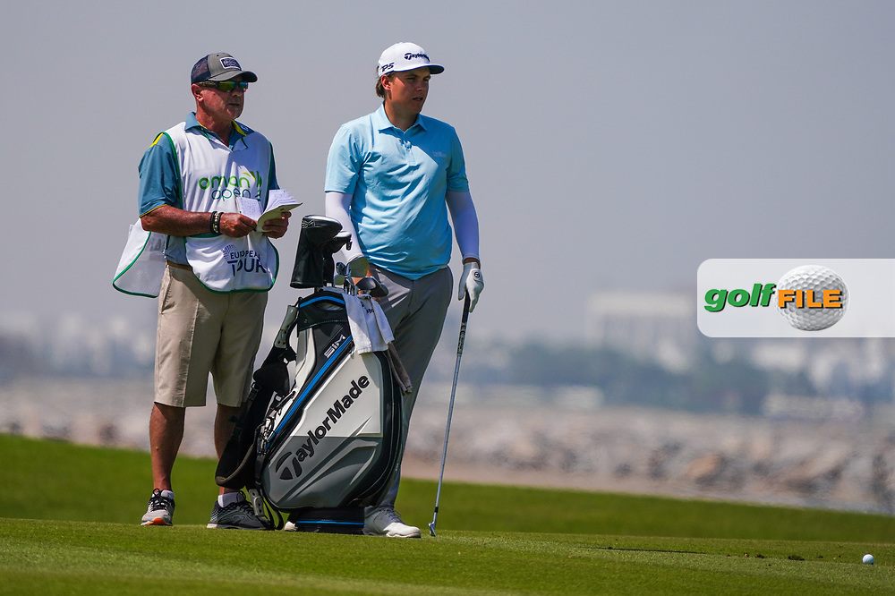 Sami Valimaki (FIN) and his caddy Kyle Roadley on the 9th during Round 3 of the Oman Open 2020 at the Al Mouj Golf Club, Muscat, Oman . 29/02/2020<br /> Picture: Golffile   Thos Caffrey<br /> <br /> <br /> All photo usage must carry mandatory copyright credit (© Golffile   Thos Caffrey)