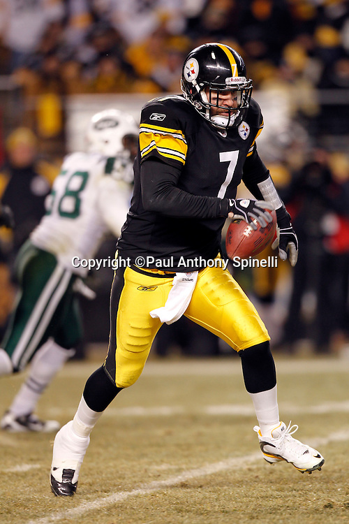 Pittsburgh Steelers quarterback Ben Roethlisberger (7) runs the ball during the NFL 2011 AFC Championship playoff football game against the New York Jets on Sunday, January 23, 2011 in Pittsburgh, Pennsylvania. The Steelers won the game 24-19. (©Paul Anthony Spinelli)