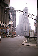 Times Square, where a Jerry Lewis film is playing and a crowd is lined up outside, is a view of New York City during August 1958.