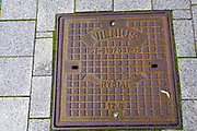 Coat of arms of Vilnius on a manhole cover in Vilnius, Lithuania