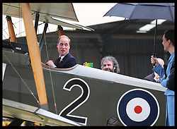 The Duke  of Cambridge sits in the cockpit of a vintage aircraft watched by the Duchess of Cambridge and Sir Peter Jackson at the Omaka Aviation Heritage Centre in Blenheim, New Zealand, Thursday, 10th April 2014. Picture by Stephen Lock / i-Images