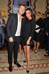 CHRISTOPHER BAILEY Chief Creative and chief executive officer of Burberry and VICTORIA BECKHAM at a party hosed by the US Ambassador to the UK Matthew Barzun, his wife Brooke Barzun and editor of UK Vogue Alexandra Shulman in association with J Crew to celebrate London Fashion Week held at Winfield House, Regent's Park, London on 16th September 2014.