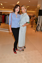 Left to right, JASMINE GUINNESS and LAURA BAILEY at the launch of the 'Jasmine for Jaeger' fashion collection by Jasmine Guinness for fashion label Jaeger held at Fenwick's, Bond Street, London on 9th September 2015.