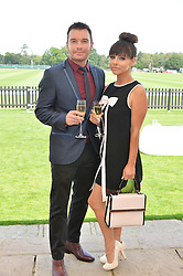 Left to right, GREG BURNS and ROXANNE PALLETT at the Audi International Polo at Guards Polo Club, Windsor Great Park, Egham, Surrey on 26th July 2014.