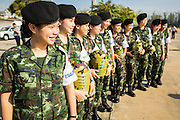 "11 JANUARY 2014 - BANGKOK, THAILAND: Thai army medics stand in a line during a Children's Day fair in Bangkok. The Royal Thai Army hosted a ""Children's Day"" event at the 2nd Cavalry King's Guard Division base in Bangkok. Children had an opportunity to look at military weapons, climb around on tanks, artillery pieces and helicopters and look at battlefield medical facilities. The Children's Day fair comes amidst political strife and concerns of a possible coup in Thailand. Gen Prayuth has issued mixed signal on a coup at one point saying there wouldn't be one, and later saying he wouldn't talk about a possible coup. Earlier in the week, the Thai army announced that movements of armored vehicles through Bangkok were not in preparation of a coup, but were moving equipment into position for Children's Day.      PHOTO BY JACK KURTZ"
