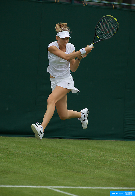 Lucie Safarova, (CZE), in action against Australian Jarmila Groth in the first round of  the All England Lawn Tennis Championships at Wimbledon, London, England on Monday, June 22, 2009. Photo Tim Clayton.