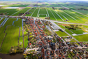 Nederland, Noord-Holland, Graft-De Rijp, 16-04-2012; De Rijp: Rechtestraat, gezien naar de Beemster, Westdijk met Beemsterringvaart. Aan de horizon Midden-Beemster. Historische regelmatige verkaveling..View on the village of De Rijp in the polder the Beemster, with circular canal Beemsterringvaart. Historic regular land division..luchtfoto (toeslag), aerial photo (additional fee required).foto/photo Siebe Swart
