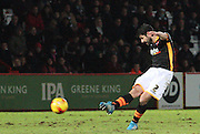Scott Bennett fires a shot at  the stevenage goal during the Sky Bet League 2 match between Stevenage and Exeter City at the Lamex Stadium, Stevenage, England on 20 December 2014. Photo by Kieran Clarke.