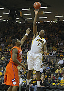 November 29, 2011: Iowa Hawkeyes forward Melsahn Basabe (1) puts up a shot over Clemson Tigers forward/center Devin Booker (31) during the first half of the NCAA basketball game between the Clemson Tigers and the Iowa Hawkeyes at Carver-Hawkeye Arena in Iowa City, Iowa on Tuesday, November 29, 2011. Clemson defeated Iowa 71-55 in the Big Ten-ACC Challenge game.
