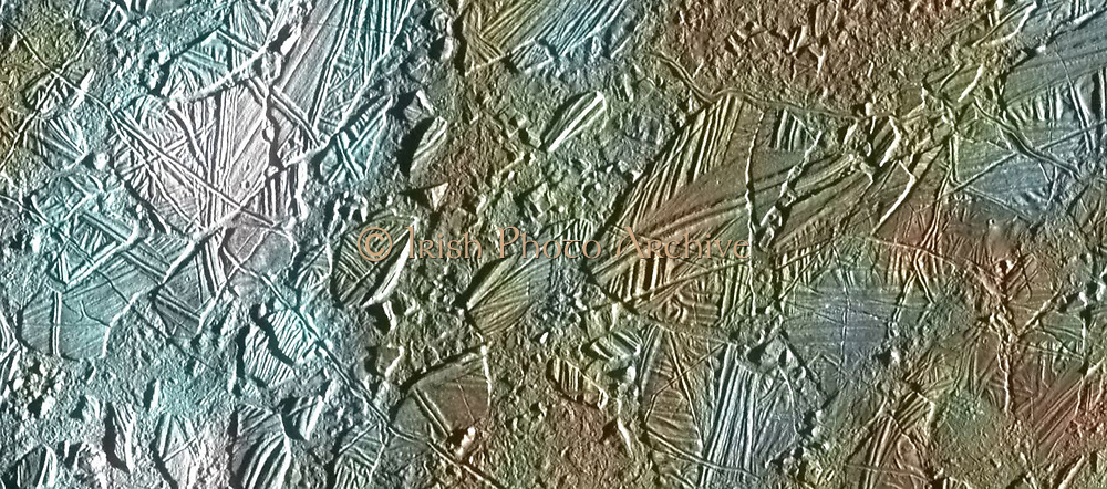 View of a small region of the thin, disrupted, ice crust in the Connemara region of Jupiter's moon Europa showing the interplay of surface colour with ice structures. The white and blue colours outline areas that have been blanketed by a fine dust of ice particles ejected at the time of formation of the large (26 kilometre in diameter) crater Pwyll some 1000 kilometres to the south.