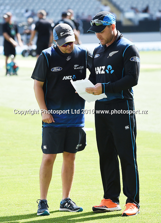 Mike Hesson and Brendon McCullum check team sheets during the New Zealand Black Caps v Pakistan 3rd ODI cricket match. Eden Park, Auckland, New Zealand. Saturday 31 January 2016. Copyright photo: Andrew Cornaga / www.photosport.nz