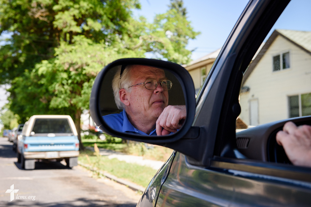 The Rev. Doug Wagley, pastor of New Vision Lutheran Church, Spokane, Wash., looks out his windshield after dropping off church members following worship on Sunday, June 18, 2017, in Spokane. LCMS Communications/Erik M. Lunsford