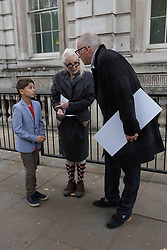 © Licensed to London News Pictures. 26/10/2017. LONDON, UK.  Nine-year-old Oliver Simpson, who wrote to Prime Minister Theresa May about his fracking fears, Vivienne Westwood and her son, Joe Corre outside Downing Street where they were refused access to deliver a letter to the Prime Minister. Oliver wrote about Swiss Petrochemical Giant Ineos seeking an Injunction to prevent any protest from the villagers of Marsh Lane, Derbyshire, where he lives.  Photo credit: Vickie Flores/LNP