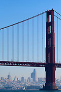 San Francisco Bay and the San Francisco Skyline as seen from under the Golden Gate Bridge with sailboats.