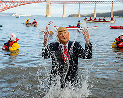 Thousands of people, many in fancy dress including Steve Bourke from Australia as Donald Trump, took part in the annual Loony Dook New Years swim in the Firth of Forth at Queensferry in the shadow of the iconic Forth Bridges today.<br /> <br /> © Dave Johnston / EEm