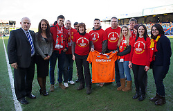 OLDHAM, ENGLAND - Sunday, January 27, 2013: Liverpool supporters from the Reds' Rose Walk in Support of the Hillsborough charities HFSG & HJC are presented with an Oldham Athletic shirt before the FA Cup 4th Round match at Boundary Park. (Pic by David Rawcliffe/Propaganda)