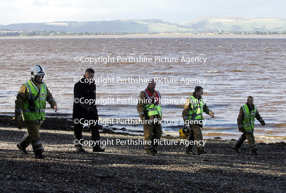 Police and Firefighters searching the shorleine near Newburgh in Fife looking for 16 year old Michael Udall who slipped into the Firth of Tay from a pier last night whilst fishing with a friend.<br />