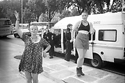 Female ravers posing in front of police at the 2nd Criminal Justice March, Victoria, London, UK, 23rd of July 1994.