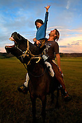 Autistic child Rowan, 5, rides a horse in Mongolia, accompanied by his parents Rupert and Kristin, their Mongolian guide Tulga, his six-year-old son Bodibilguunson and an American documentary TV crew. .Rowan's parents believe horses and shamans can unlock their sonís autistic mind. This is their journey of discovery across Mongolia on horseback. .The story is published by the Sunday Times and accompany text by Tim Rayment.