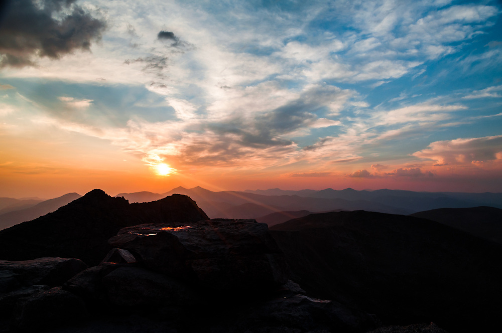 This is a picture from the summit of Mount Evans showing the sunset on the Colorado Front Range Mountains.<br /> <br /> Camera <br /> NIKON D5000<br /> Lens <br /> 16.0-85.0 mm f/3.5-5.6<br /> Focal Length <br /> 16<br /> Shutter Speed <br /> 1/160<br /> Aperture <br /> 6.3<br /> ISO <br /> 200