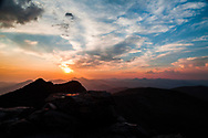 This is a picture from the summit of Mount Evans showing the sunset on the Colorado Front Range Mountains.<br />